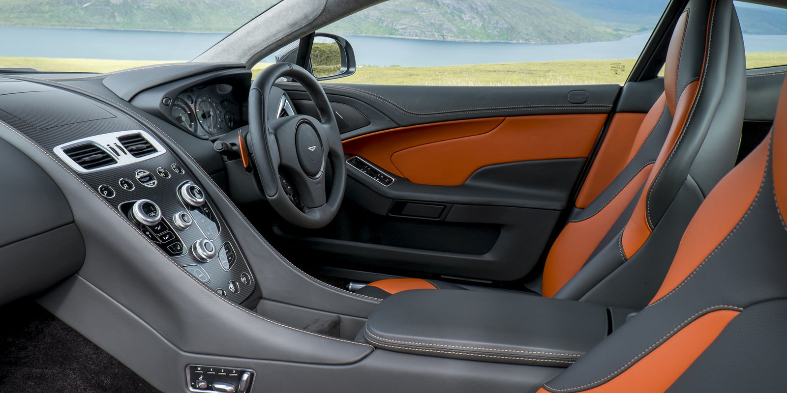 The new interior inspired by the one 77 goes down well most of it does at least memorable for all the wrong reasons is the squared off steering wheel